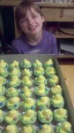 Emmie and some of the 200 cupcakes